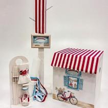 """Χειροποίητο βαπτιστικό κουτί το""""Μπακάλικο"""" by Elena Manakou  Χειροποίητο ξύλινο κουτί βάπτισης """"Το Μπακάλικο"""", είναι ζωγραφισμένο στο χέρι και διακοσμημένο με κόκκινο ριγέ ύφασμα και συνδυάζεται με τη λαμπάδα, το λαδοσετ (μπουκαλάκι, σαπουνάκι και 3 μικρά κεράκια) όλα στο ίδιο ύφος με το κουτί."""